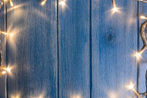 Christmas lights on wooden table