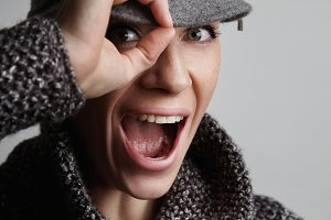 woman wears grey coat