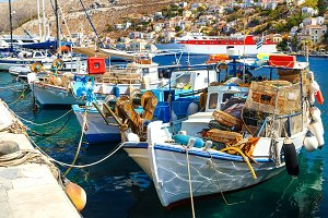 traditional small fishing boats docked in main port of Symi island in Greece