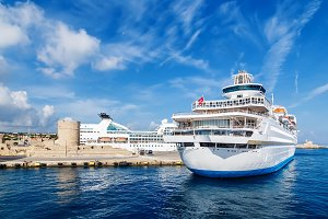 big white cruise ship in the port of the island  Rhodes Greece