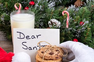 Santa reaching for a cookie