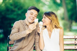 man and woman sitting eating ice cream