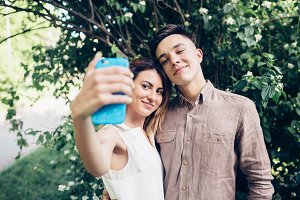 man and woman make selfie