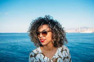 Woman with red lips and sunglasses