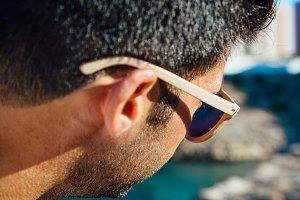 Stylish brunet man in sunglassses