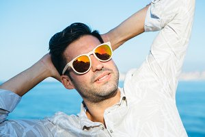Happy stylish man in sunglasses