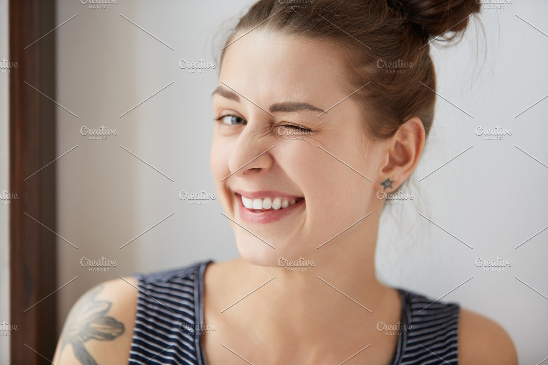 Nice Close Up Portrait Of Young European Hipster Girl With Bunch Of Brown Hair And Tattoo Happy Tricky Cute Woman With Smiling Face Blinking At