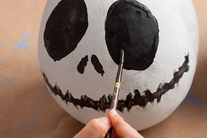 Painting a halloween pumpkin