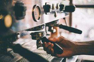 Barista makes coffee