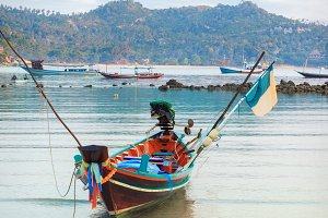 Traditional asian colorful long tail boat