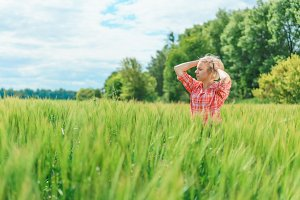 Portrait of beautiful girl in green field