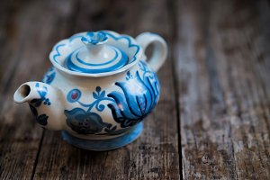 Blue chinese teapot on wooden background