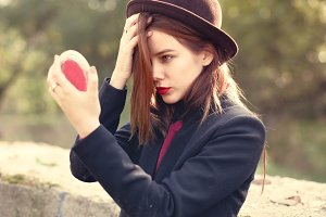 girl in a brown hat with red lips