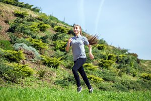 Photo of young blonde woman doing running activities
