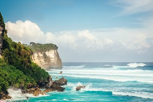 Powerful waves of Indian ocean hitting cliff in Bali, Indonesia. Sea nature landscape