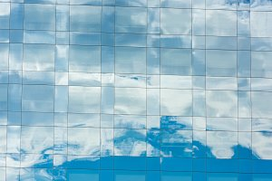 blue sky and clouds reflected