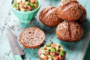 Rye sandwich buns with salmon and avocado tartare