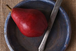 Red Pear Knife and Blue Plate
