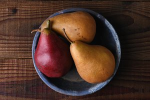 Pears on Wood Table and Blue Plate