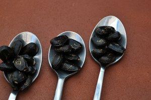 teaspoons with dark seeds