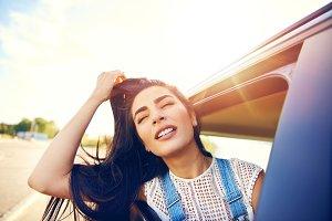 Gorgeous young woman enjoying a road trip