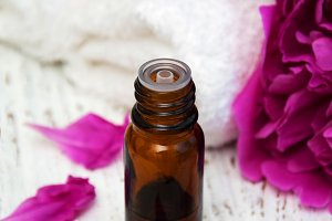 Massage oil and peony flowers