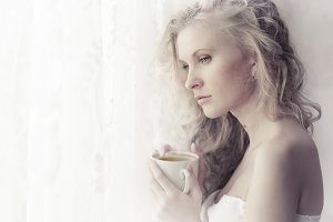sensual blonde woman at the window
