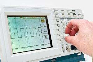 Enginner Operating an Oscilloscope