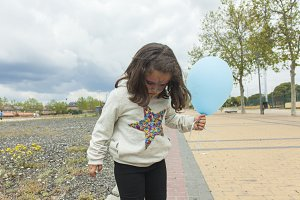 Girl with painted face and a balloon