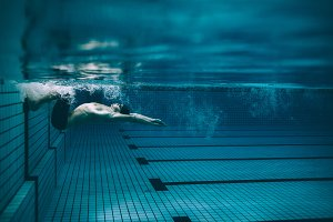 Male swimmer turning over