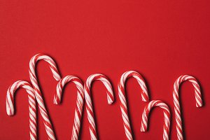 Christmas candy cane red background
