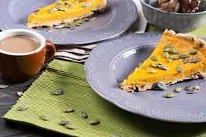 Slice of pumpkin pie with seeds