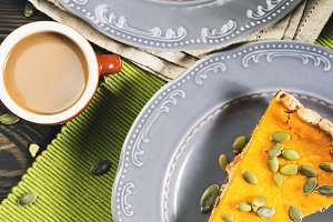 Slice of pumpkin pie and coffee