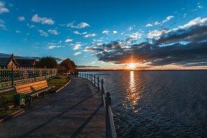 seagulls on the sunset embankment