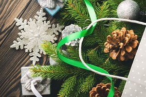 Gift bag with Christmas baubles and fir tree branches