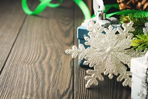 Wooden background with Christmas baubles
