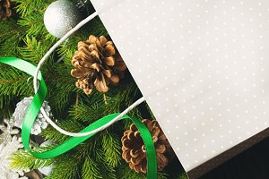 Gift bag with Christmas fir tree branches and ornaments
