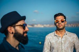 Two stylish men wearing sunglasses