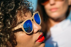 Mixed race woman in sunglasses