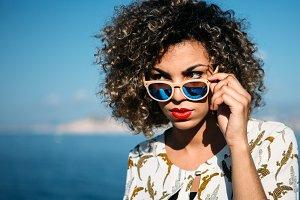 Mixed race woman wears sunglasses