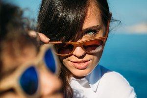 Burnett girl looking over sunglasses