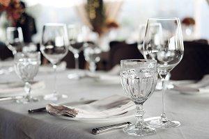 serving table glasses in restaurant