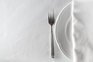 white empty plate with fork