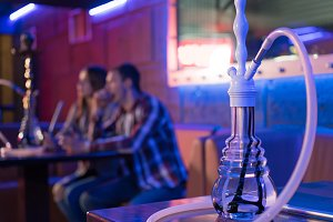 Young couple in a hookah bar.