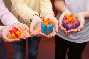 Children holding plasticine gifts