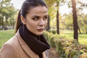 Portrait of a brunette in a coat.