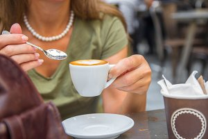 Girl having espresso