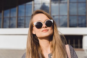 Pretty hipster girl in sunglasses