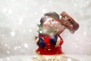 Snowman in snowfall