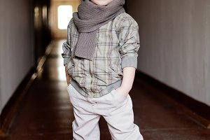 fashionable little boy in scarf